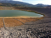Geomembrane leak detection deployed on a tailings pond at a heap leach gold mine